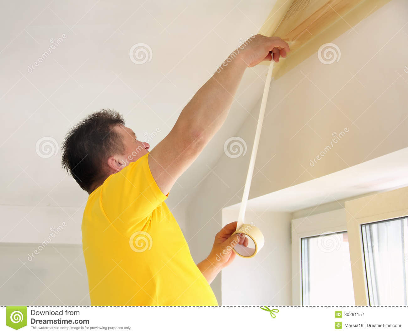 ... to the edges of the wooden ceiling beam, which he is going to paint