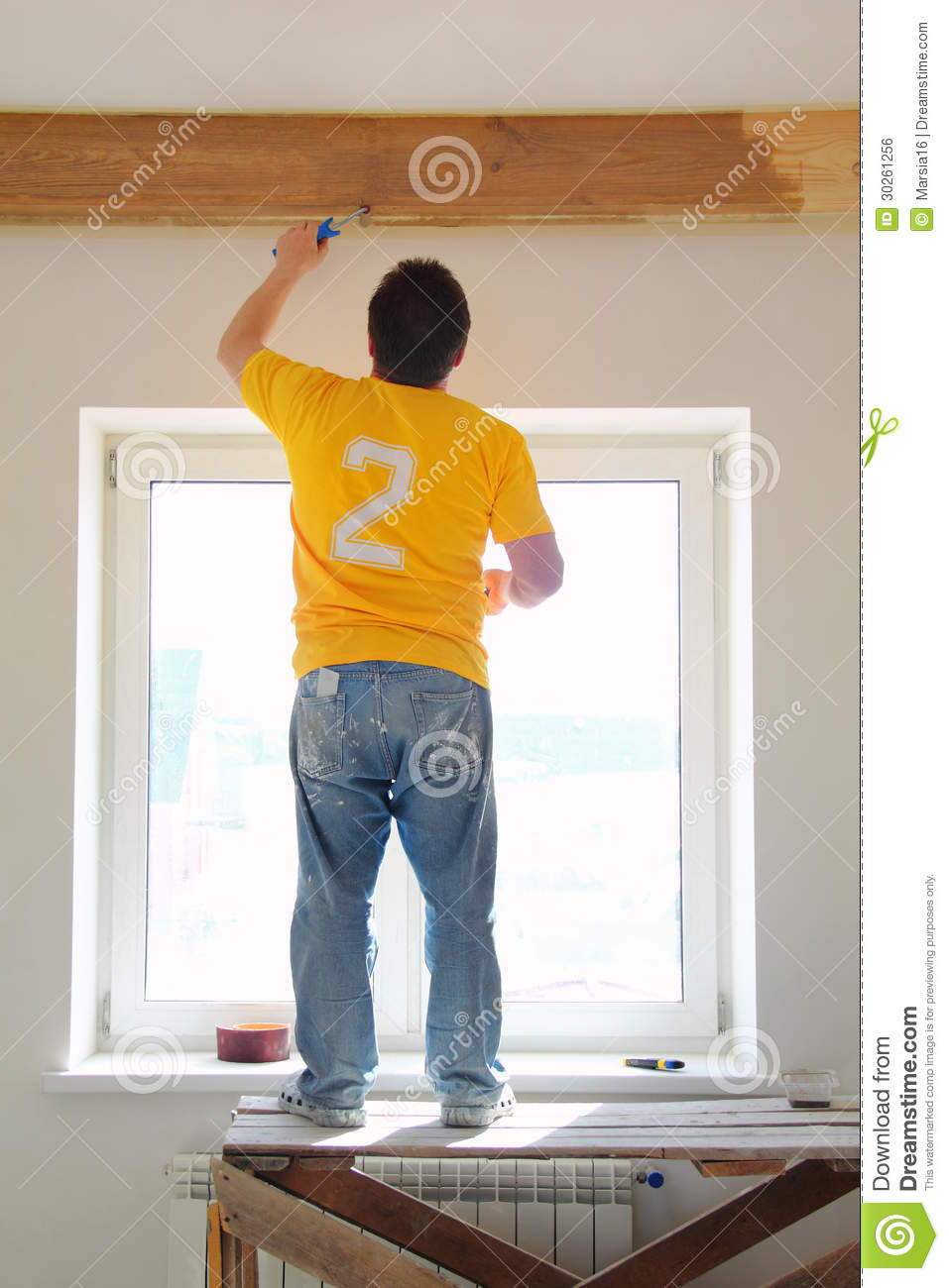 Man Painting A Exposed Beams Stock Photo Image Of Colours