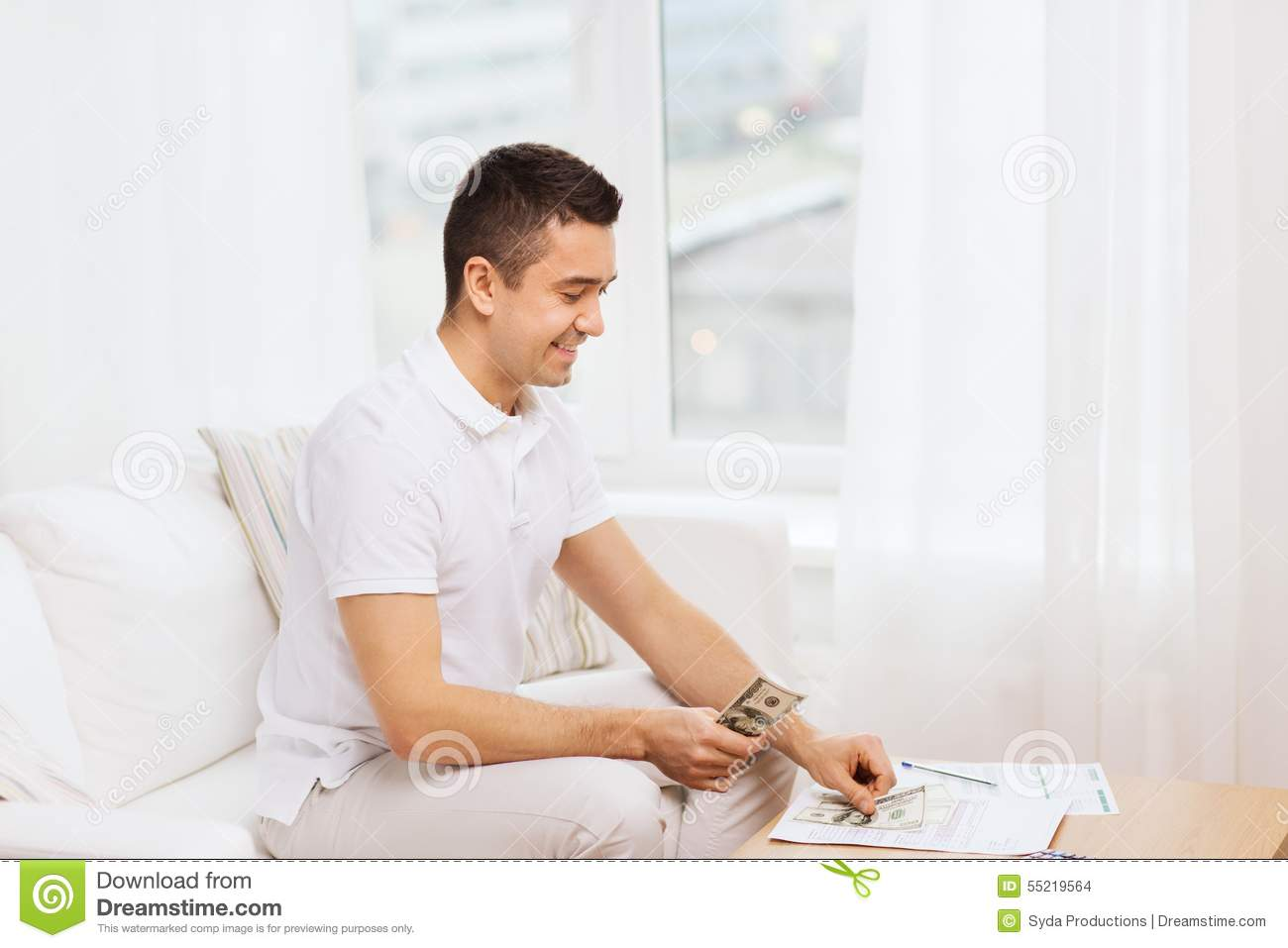 Man With Papers And Calculator At Home Stock Photo Image