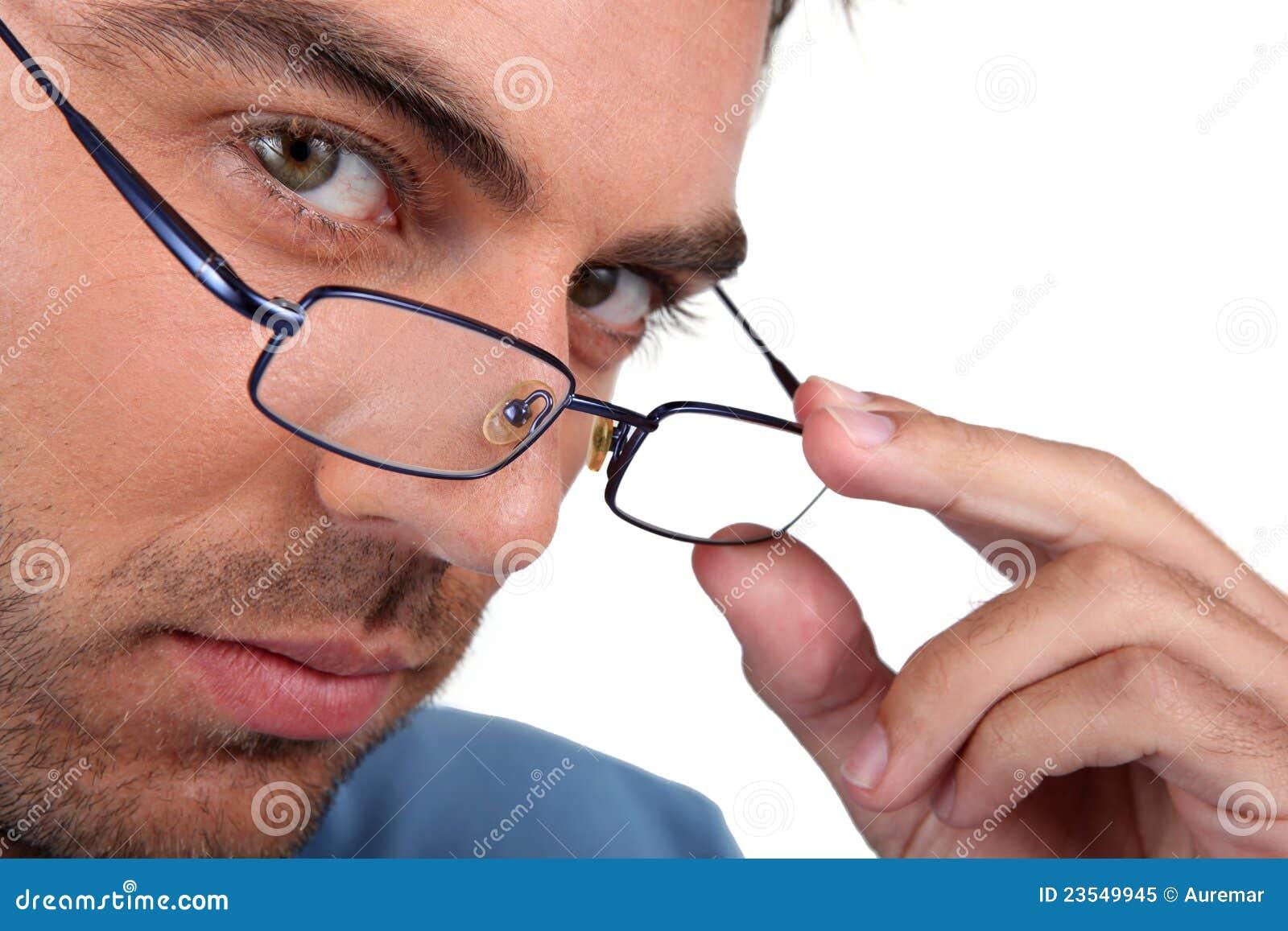 Man peering over his glasses