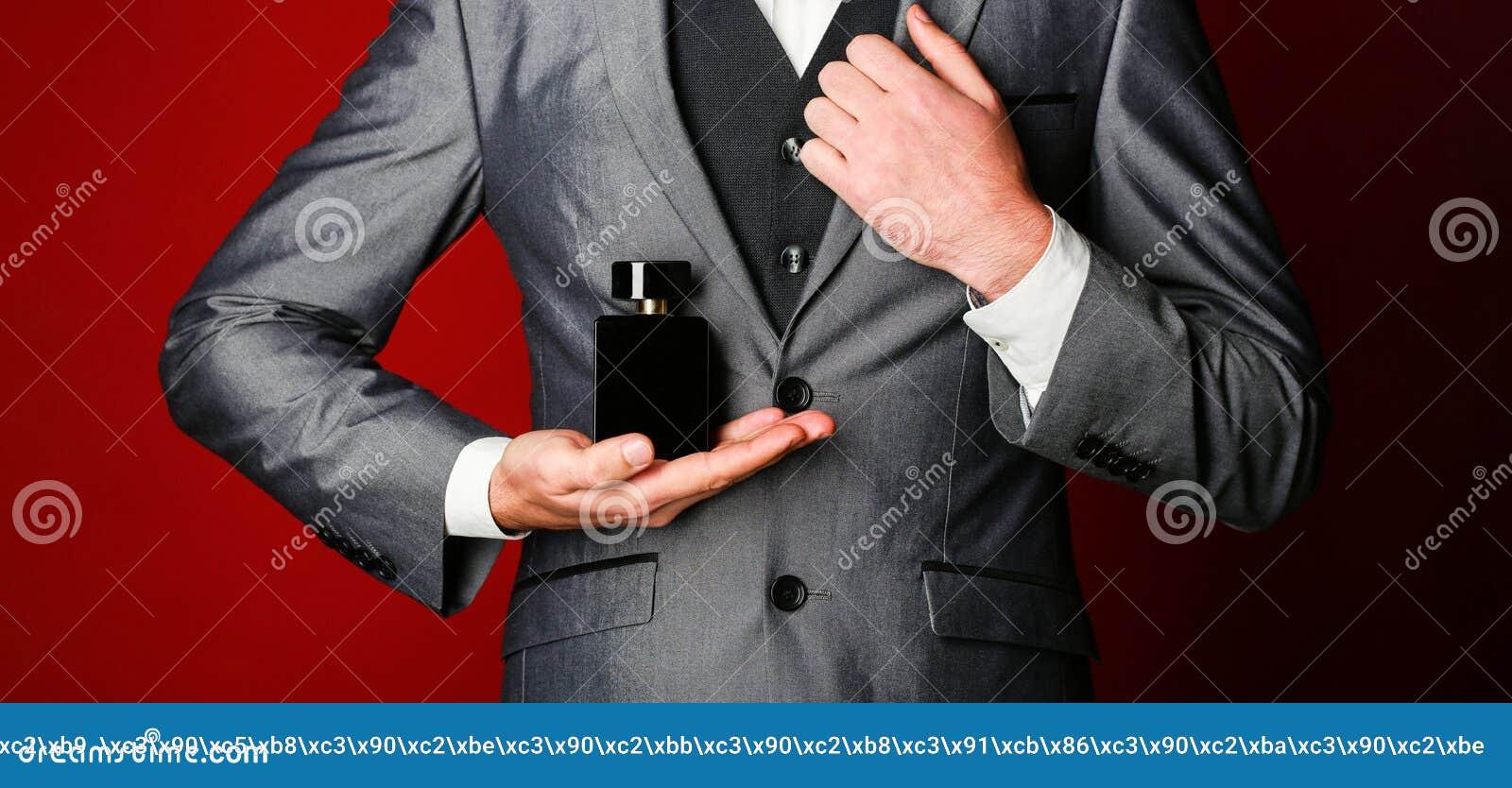Man perfume, fragrance. Masculine perfume. Perfume or cologne bottle. Male fragrance and perfumery, cosmetics. Bearded