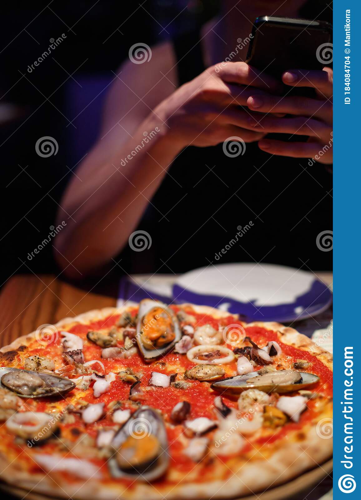 A Man Photographs Pizza In A Restaurant Or Cafe Stock Photo Image Of Marine Recipe 184084704