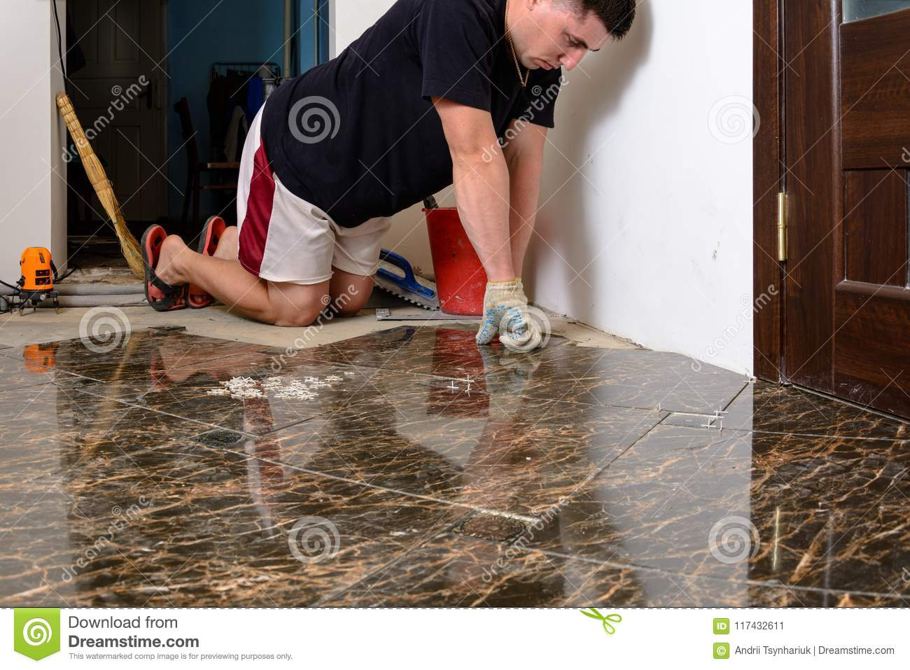 Man Placing Ceramic Floor Tile In Position Over Adhesive Stock Image - Place and press floor tiles