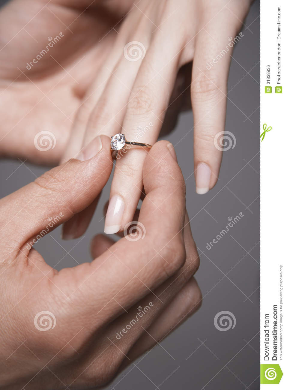 Man Placing Engagement Ring In Woman S Finger Stock Photo Image Of