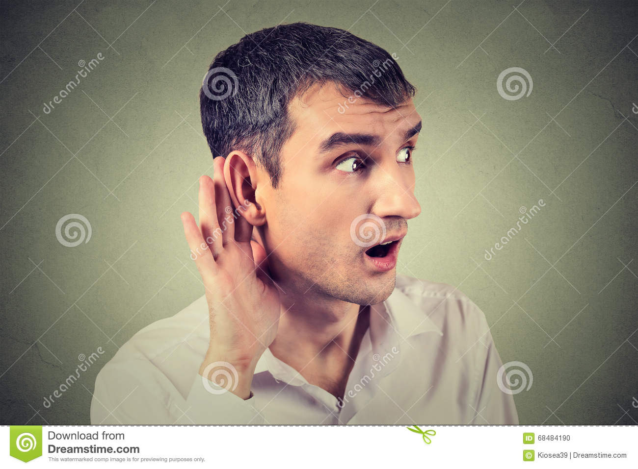 Man placing hand on ear asking someone to speak up or listening carefully to gossip
