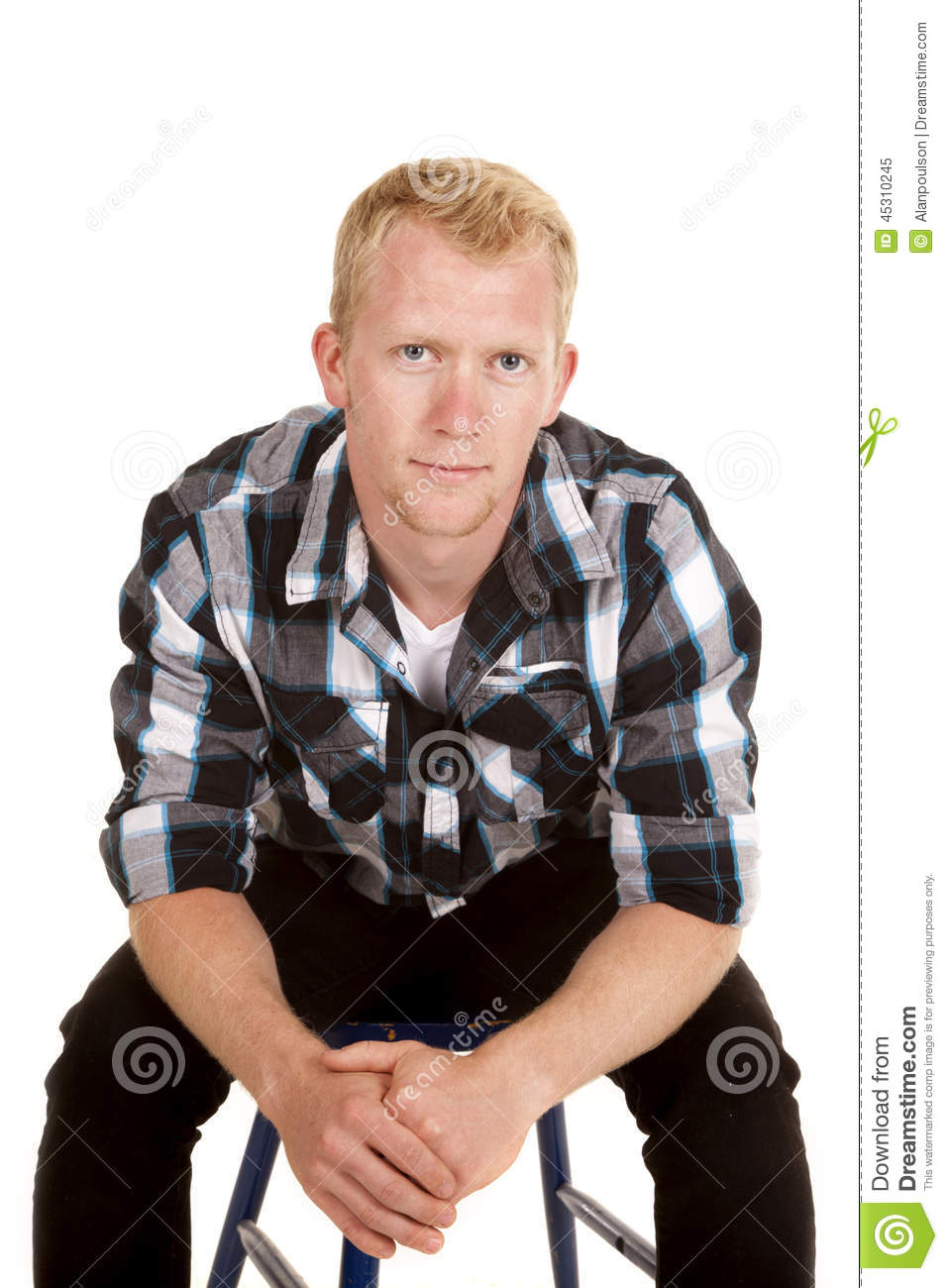 man in plaid shirt sit lean forward serious stock photo image 45310245. Black Bedroom Furniture Sets. Home Design Ideas
