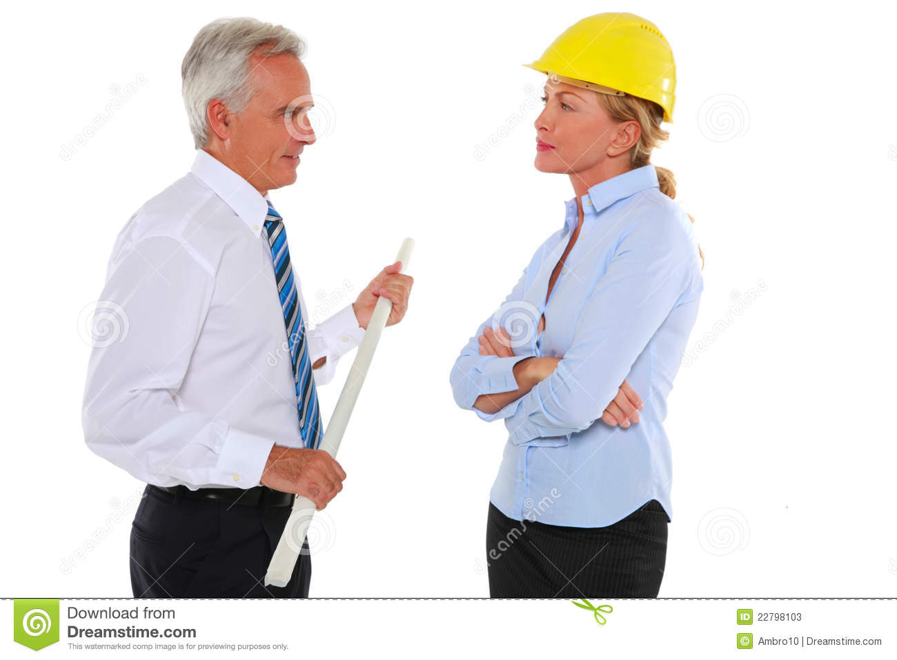 Man With Plan And Woman Architect With Hard Hat Stock