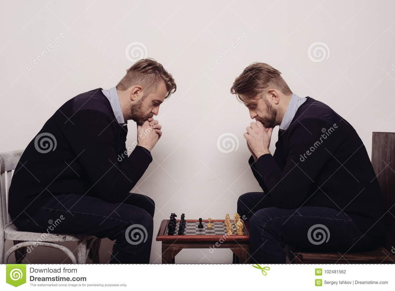 Man playing chess against himself