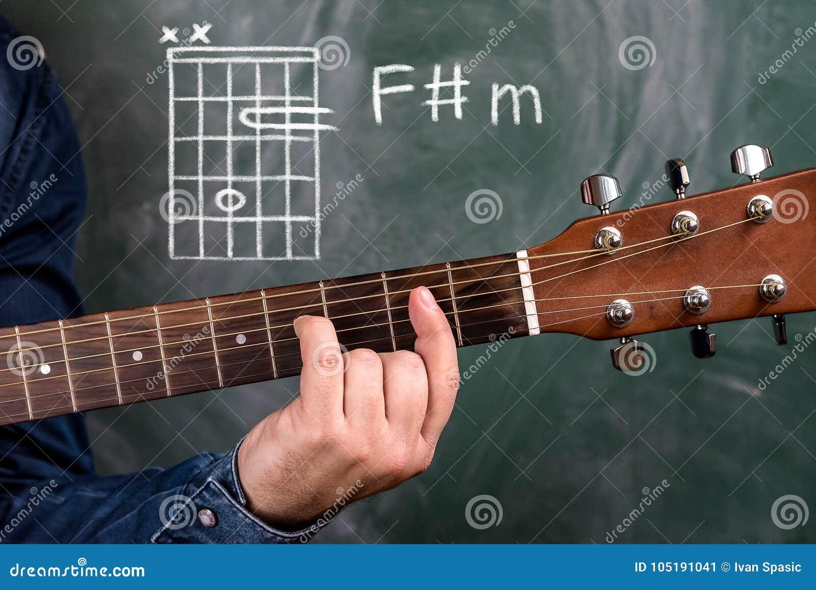 Man Playing Guitar Chords Displayed On A Blackboard Chord F Sharp M