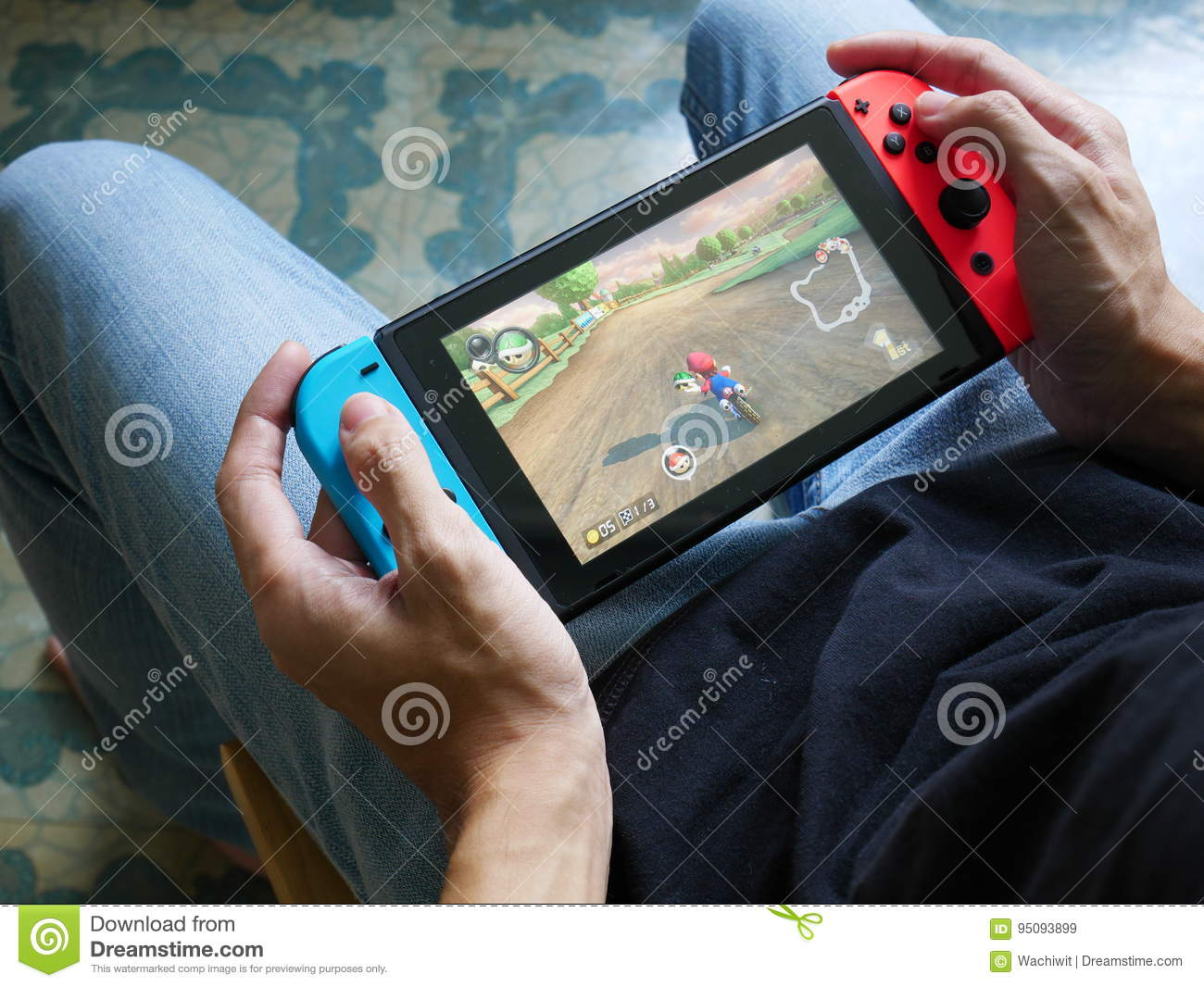 A Man Playing Mario Kart 8 Deluxe On Nintendo Switch