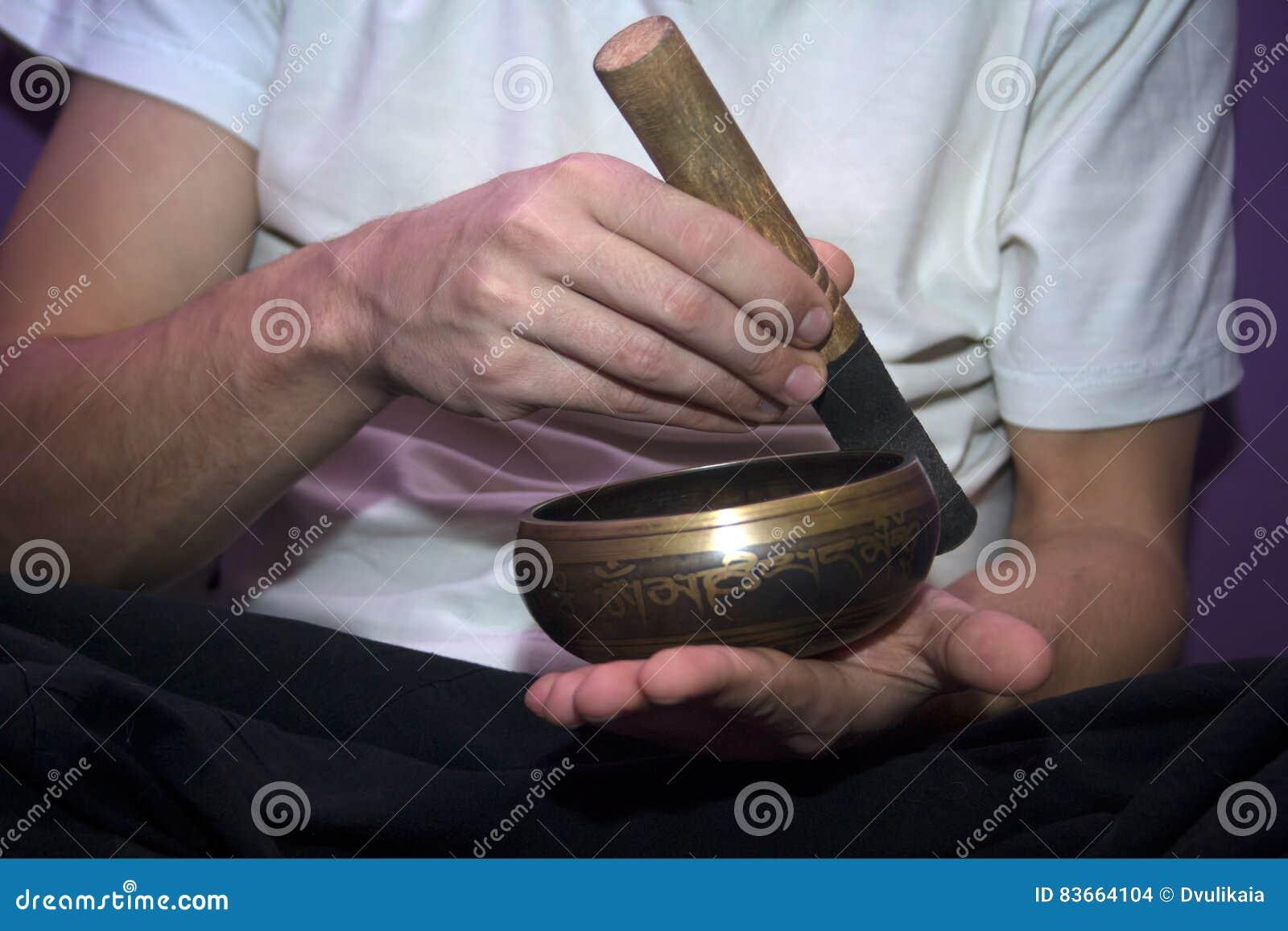 Man playing on a singing bowl