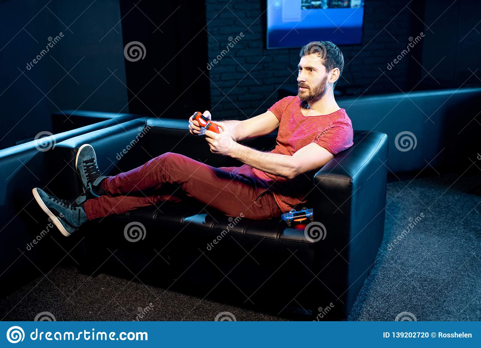 Man playing video games with gaming console in the club