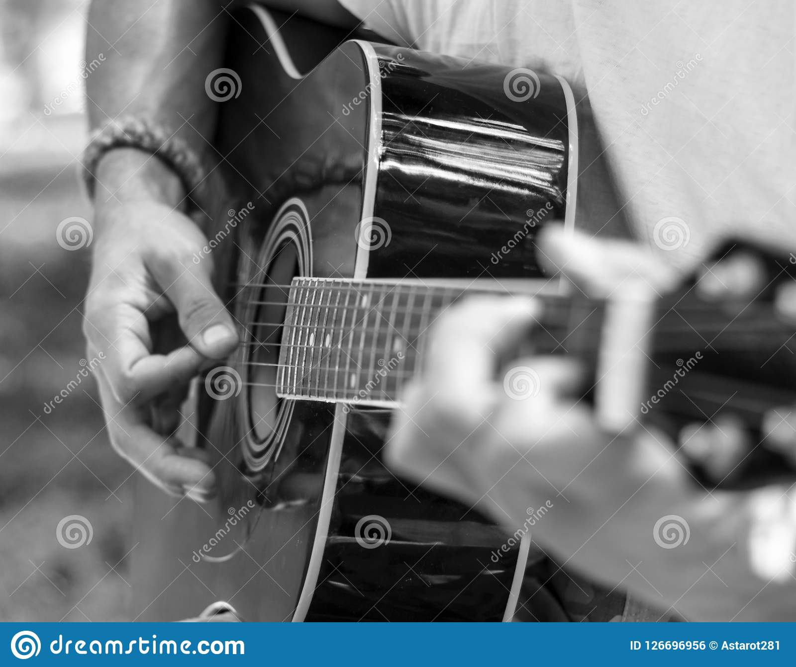 Man plays guitar in black and white tones