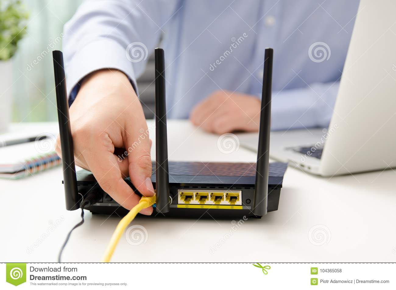 Miraculous Man Plugs Ethernet Cable Into Router Stock Photo Image Of Laptop Wiring Cloud Intapioscosaoduqqnet