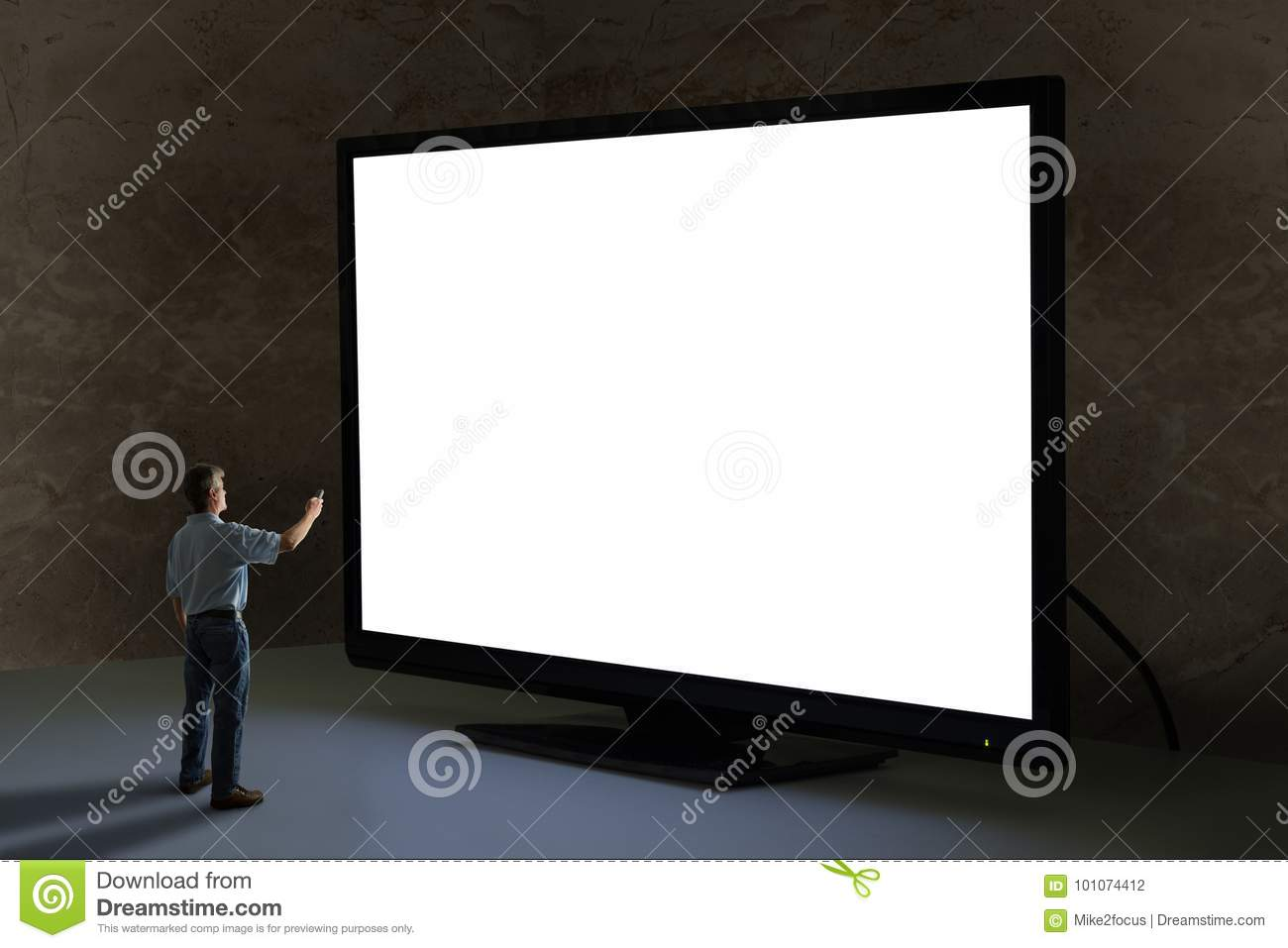 Man pointing tv remote control at world's biggest giant television with blank screen