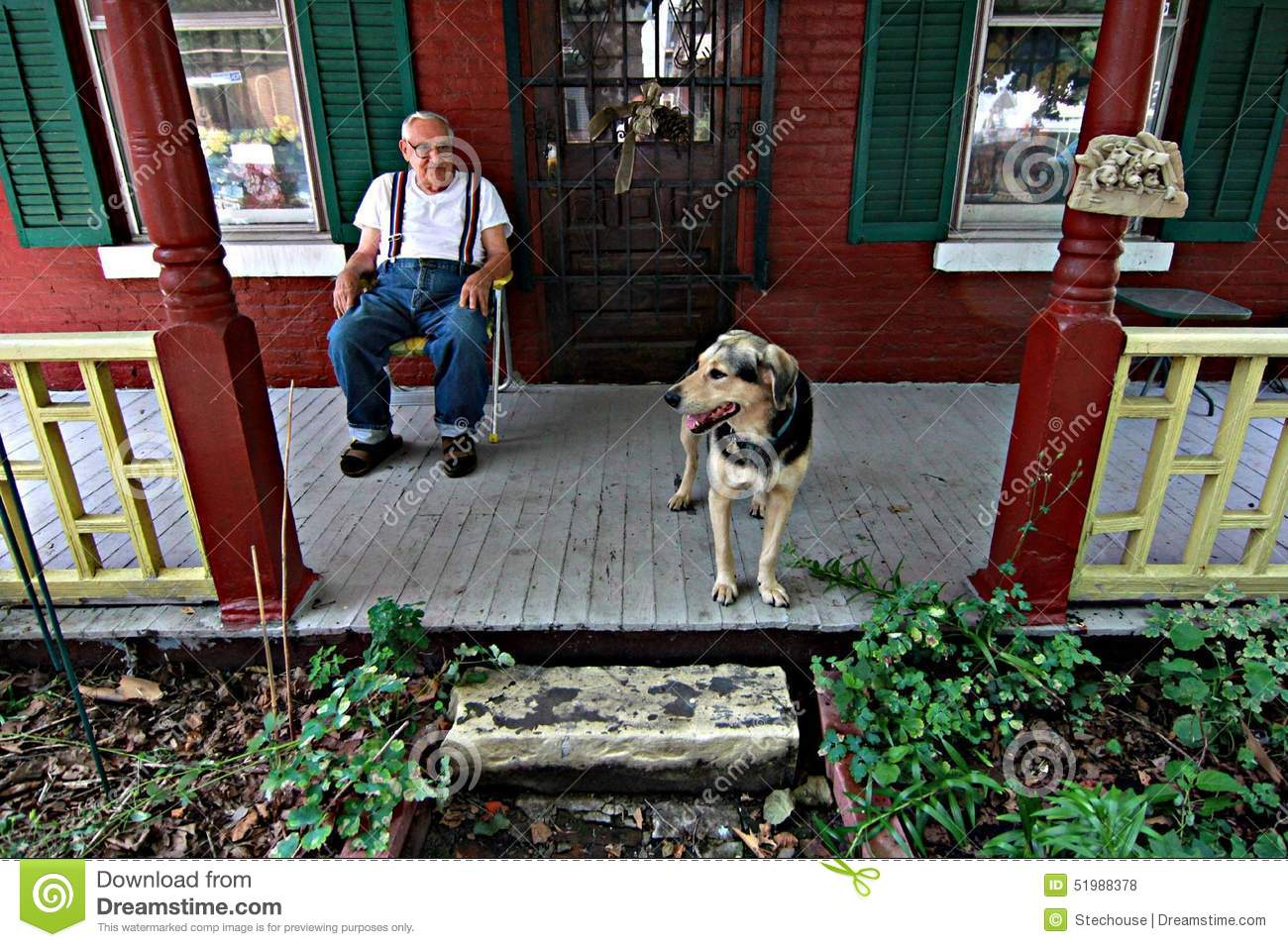 Man On Dog : Man on porch with dog editorial stock photo image