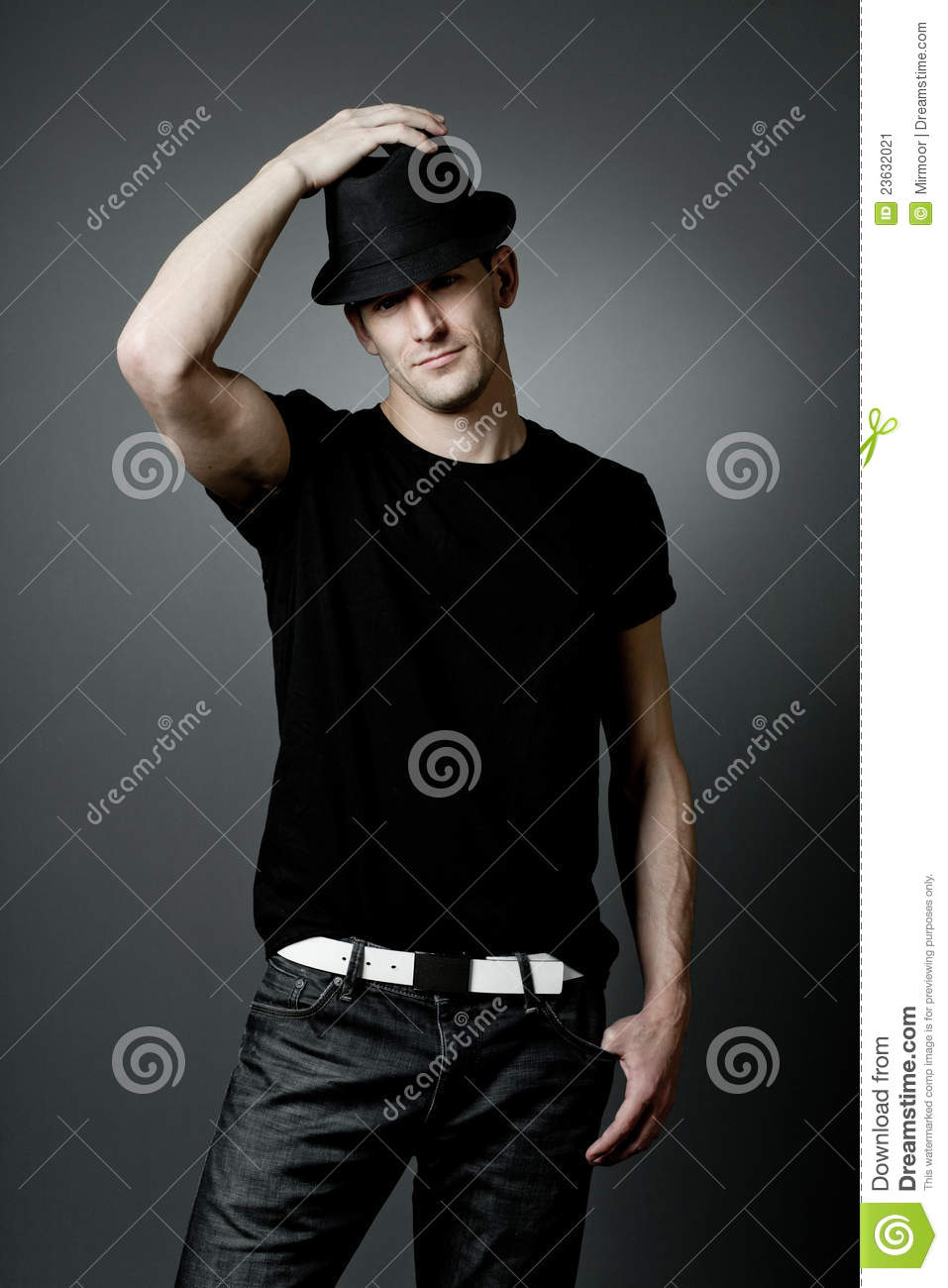cb649d2343b Man Posing In Black T-shirt And Black Hat. Stock Image - Image of ...