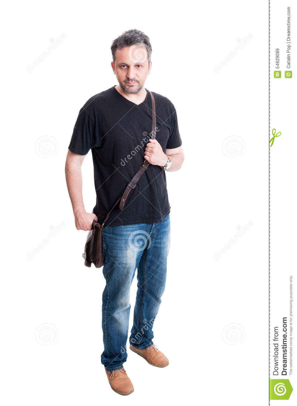 Man Posing With Jeans, Black T-shirt And Leather Bag Stock Photo ...