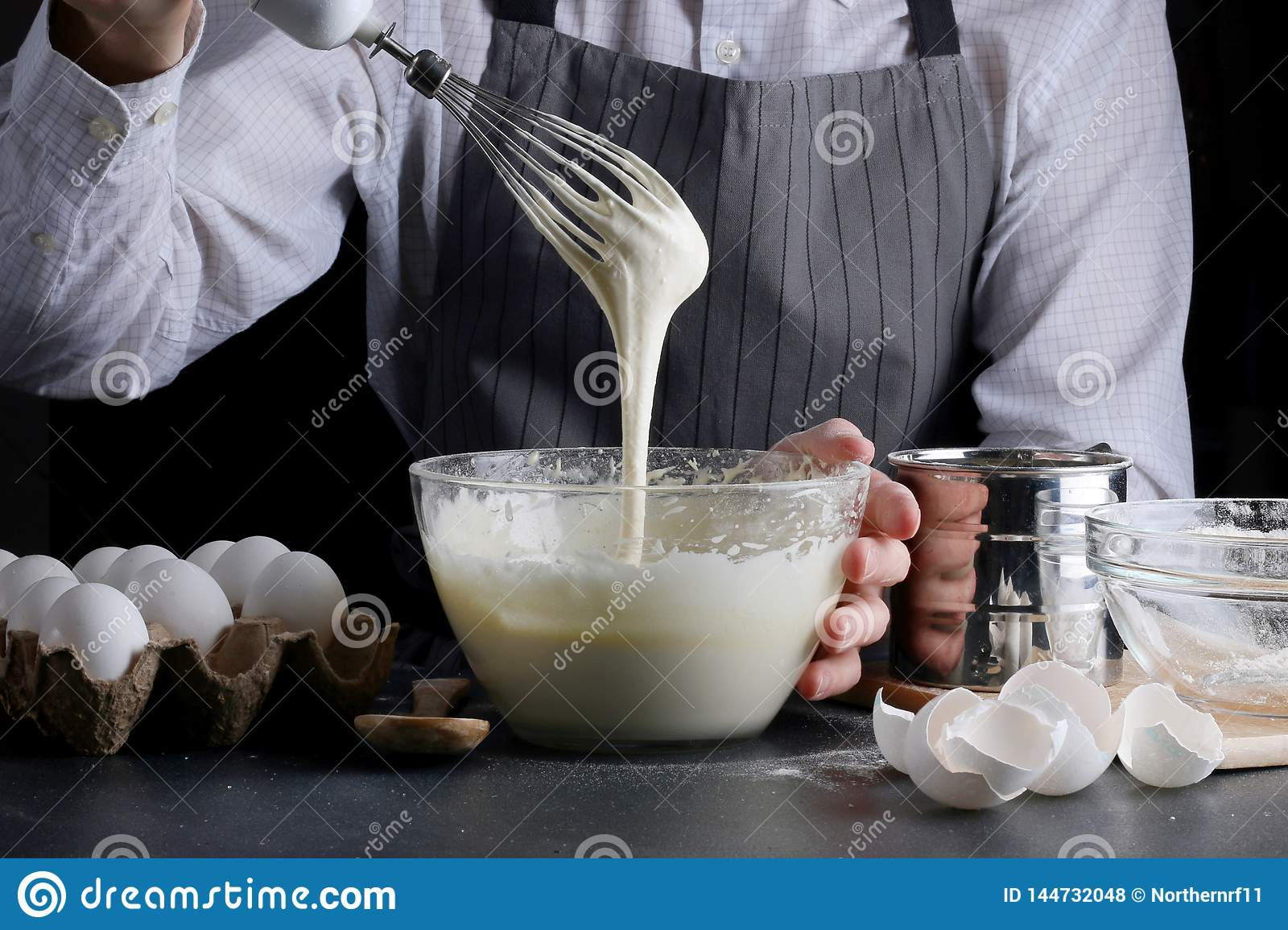 Man pouring dough for pie. cake making concept