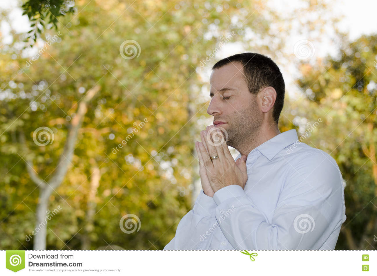 Man praying on a fall/autumn day.