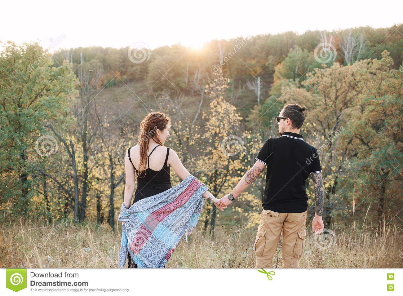Man And Pregnant Woman Hugging Holding Hands On The Background Of