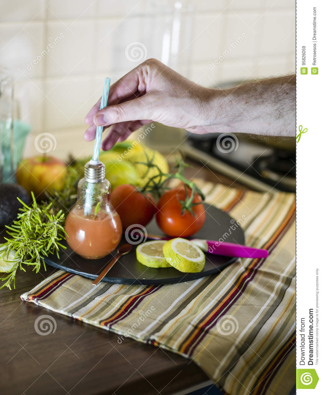 Man Preparing A Cold Cocktail Made Of Fruits And Erbs From A