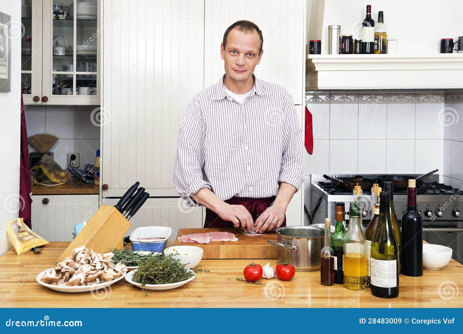 Royalty Free Stock Photo. Download Man Preparing Meat At Kitchen ...