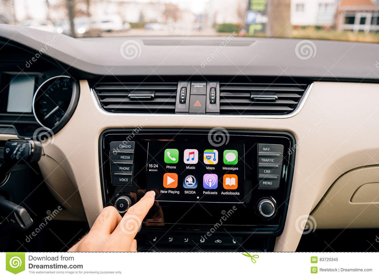 Man Pressing Home Button On The Apple CarPlay Main Screen Editorial Image