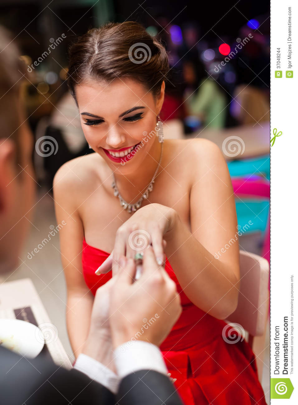 Man proposing with an engagement ring to his love