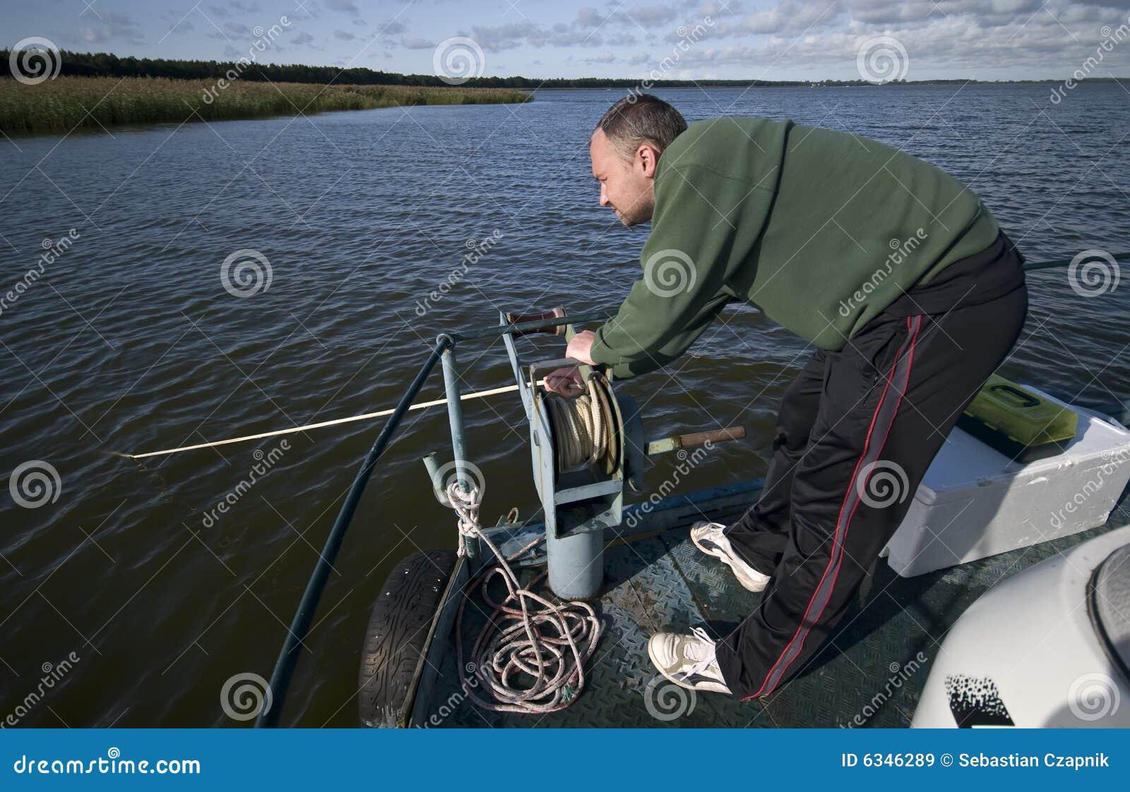 man pulling anchor rop...