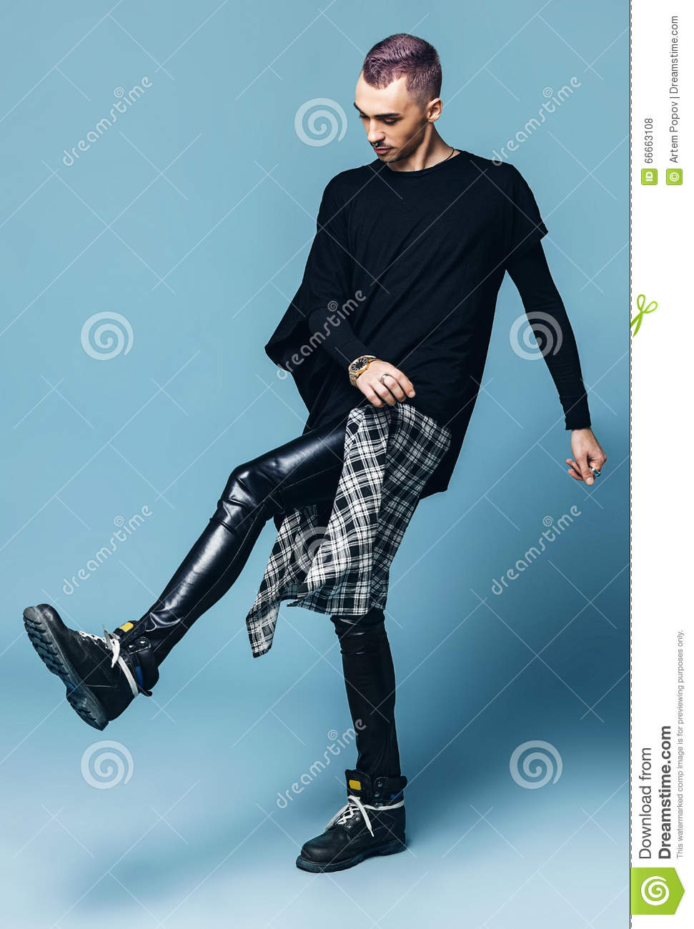 Man With Purple Hair Kicking Leg In Black Pants Stock Photo Image