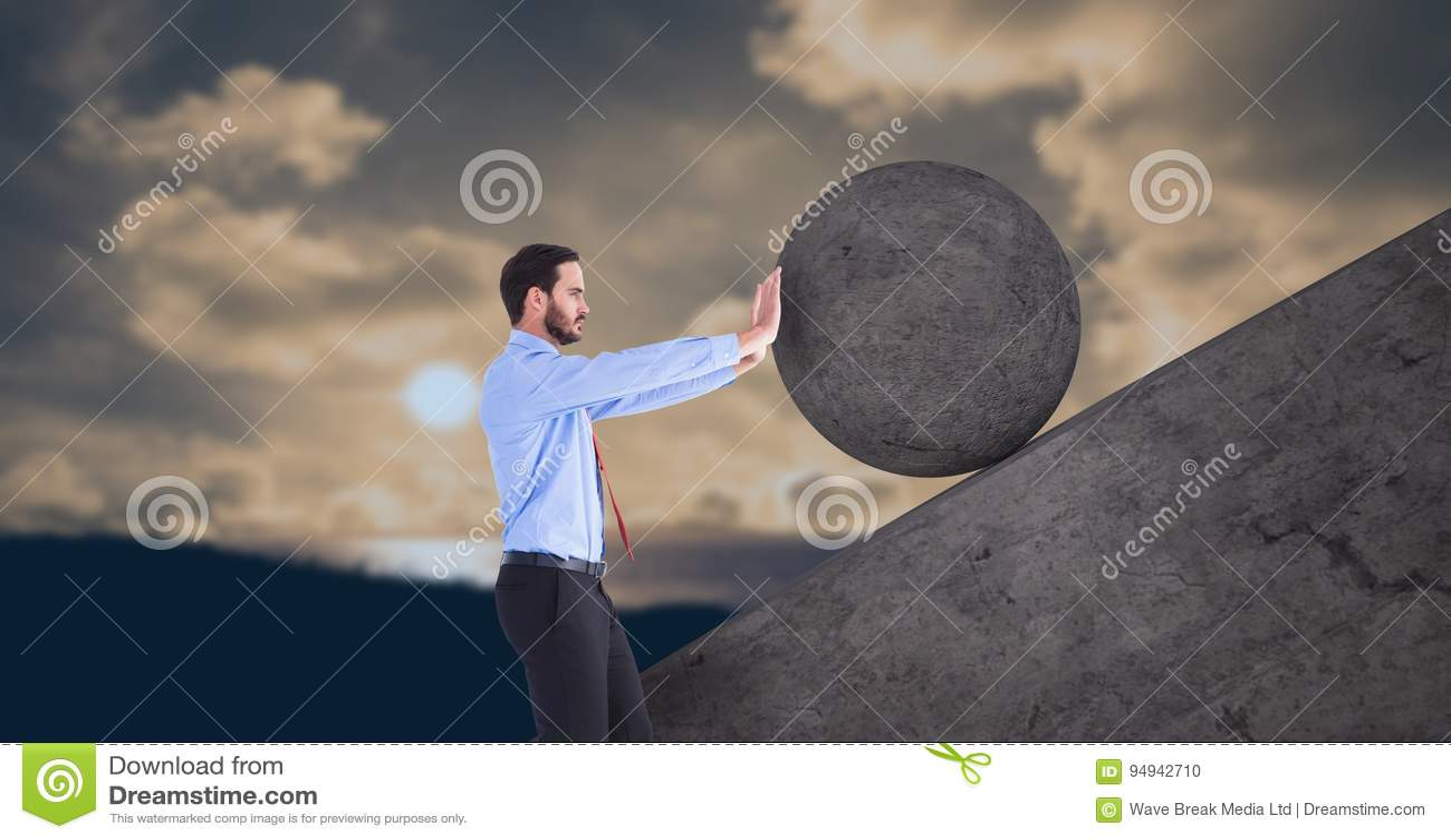 Man pushing rolling round rock