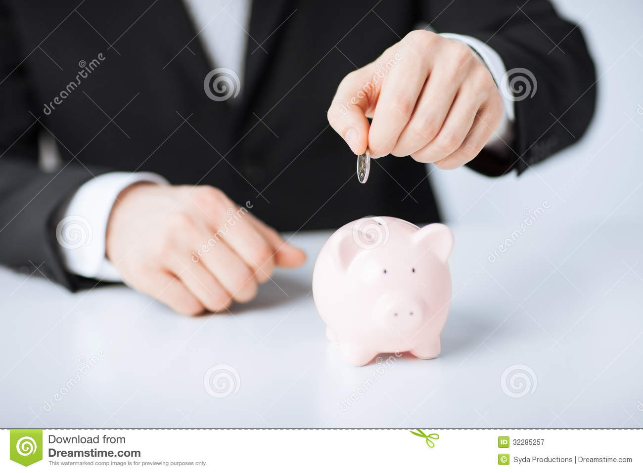 Man Putting Coin Into Small Piggy Bank Stock Image Image