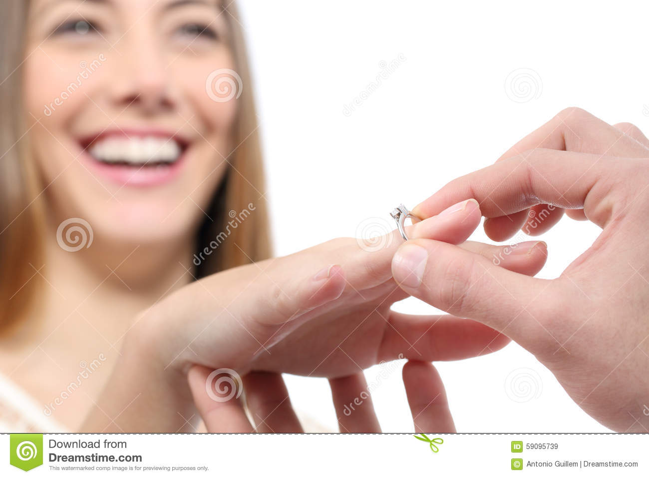 Man Putting A Engagement Ring After Proposal Stock Photo
