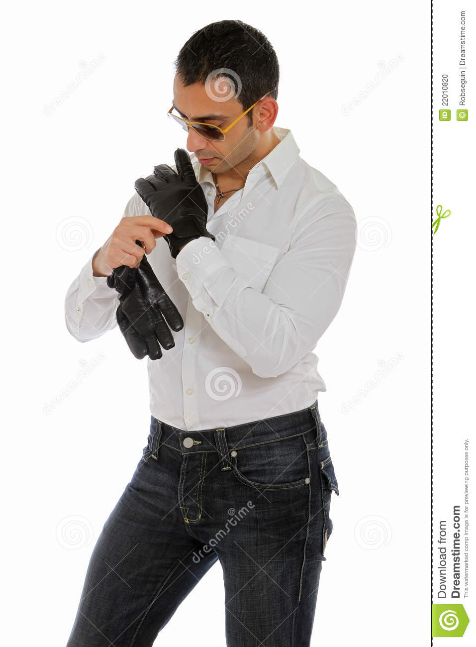 Man Putting On A Pair Of Gloves Stock Photo