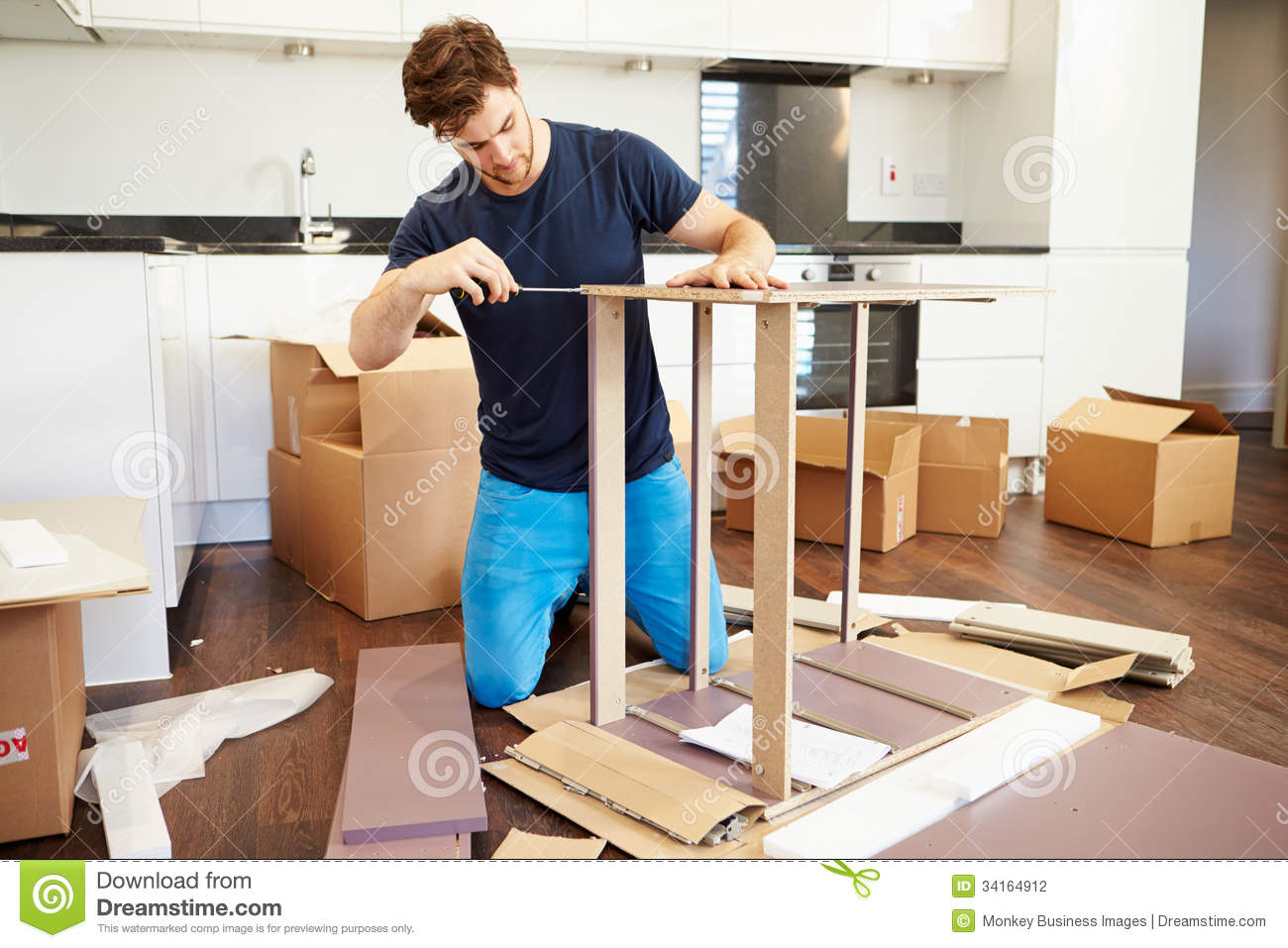 Man putting together self assembly furniture in new home for Someone to assemble ikea furniture