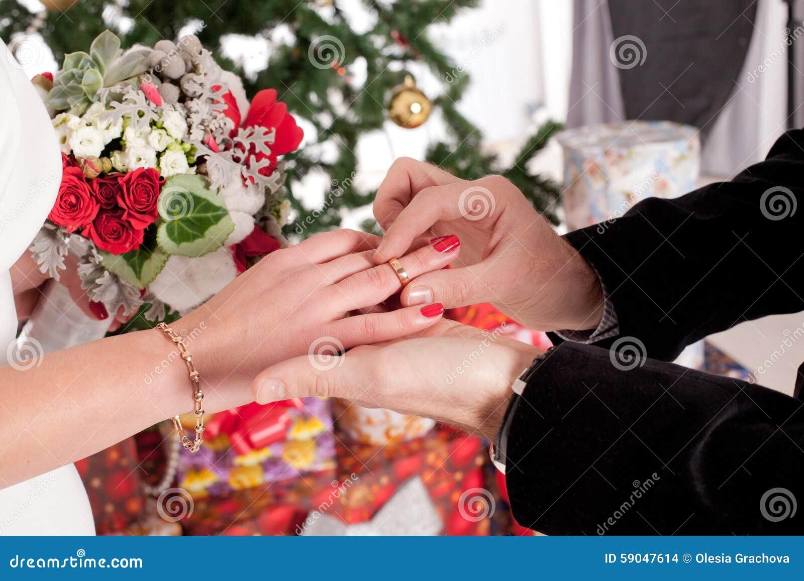 Man Putting Wedding Ring On Woman Hand Stock Photo - Image of ...