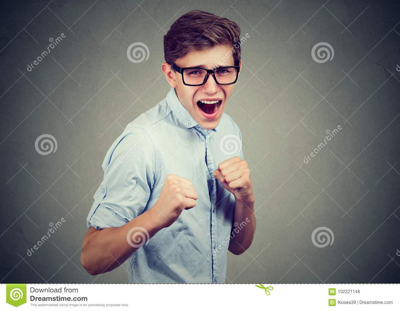 Man in rage threatening to punch someone with fists