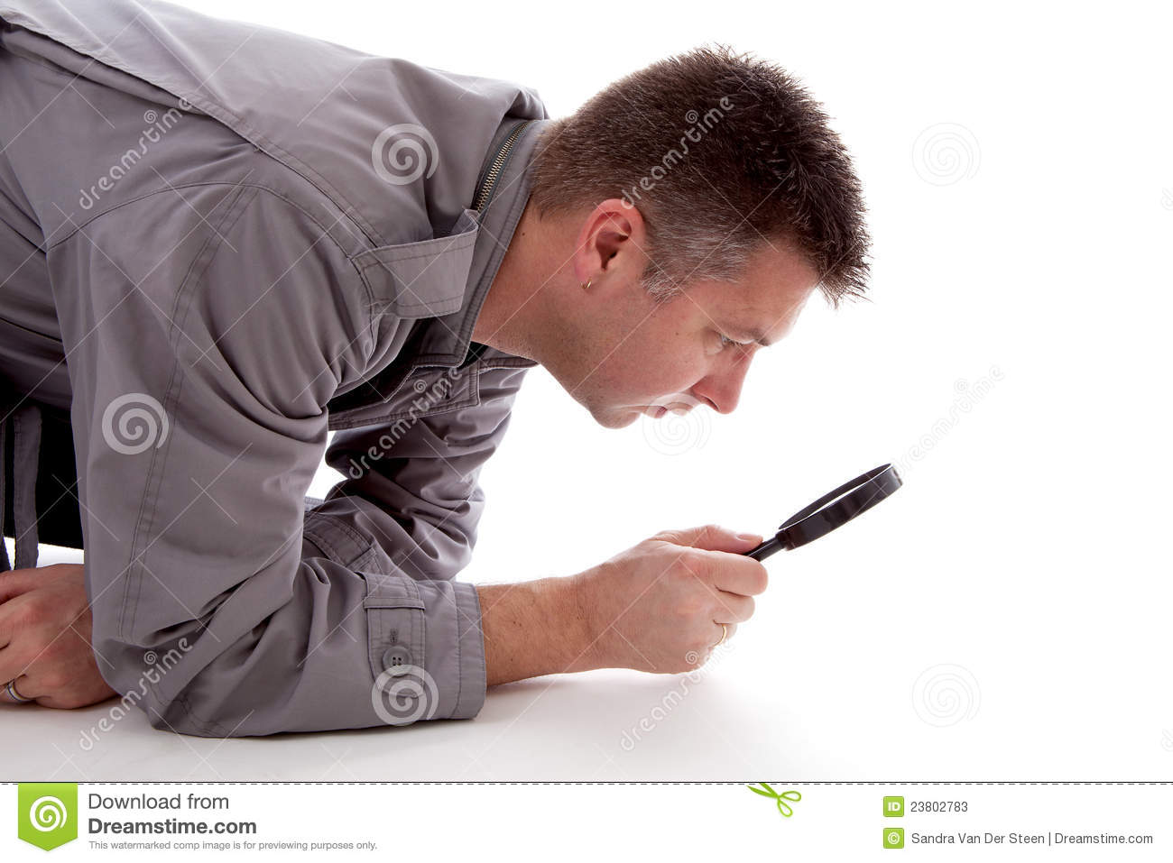 Man With Raincoat Is Looking With Magnifying Glass Stock