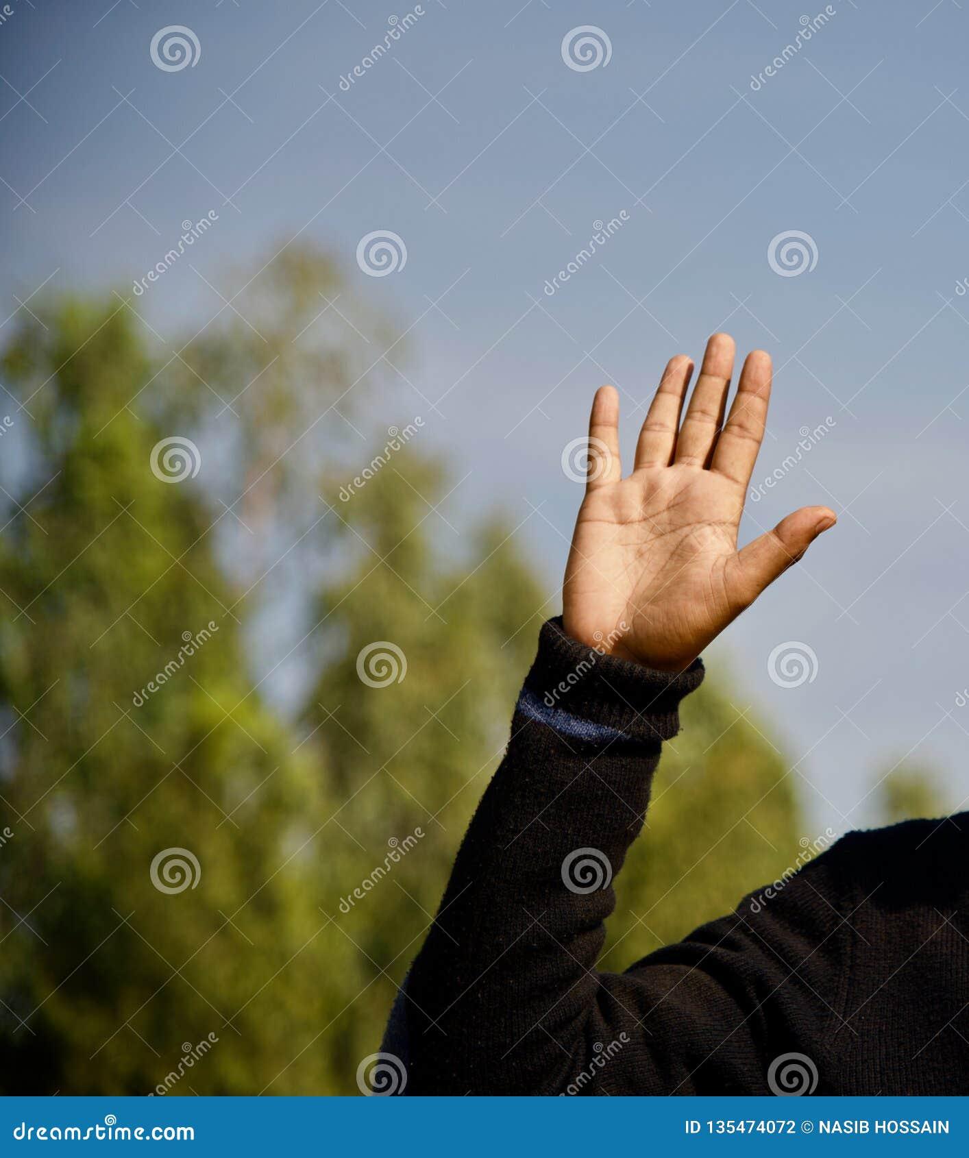 Man raising a hand unique photo