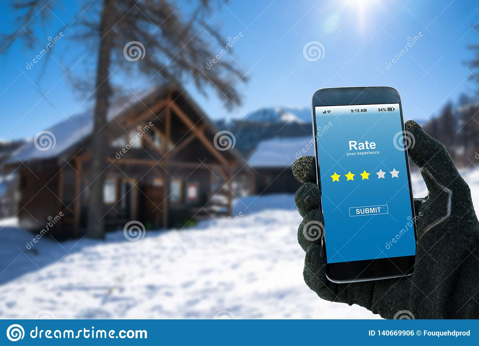 Man rating his experience with the stars on the screen of the smartphone app