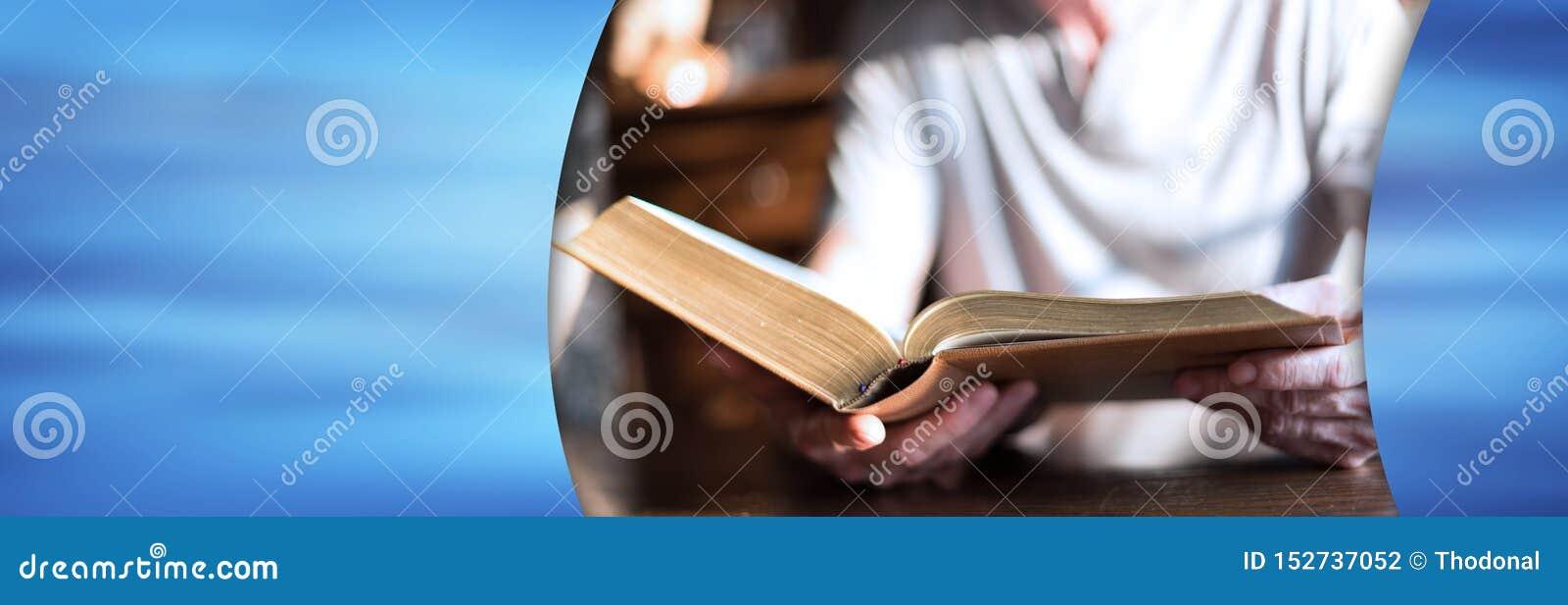 Man reading the bible; panoramic banner