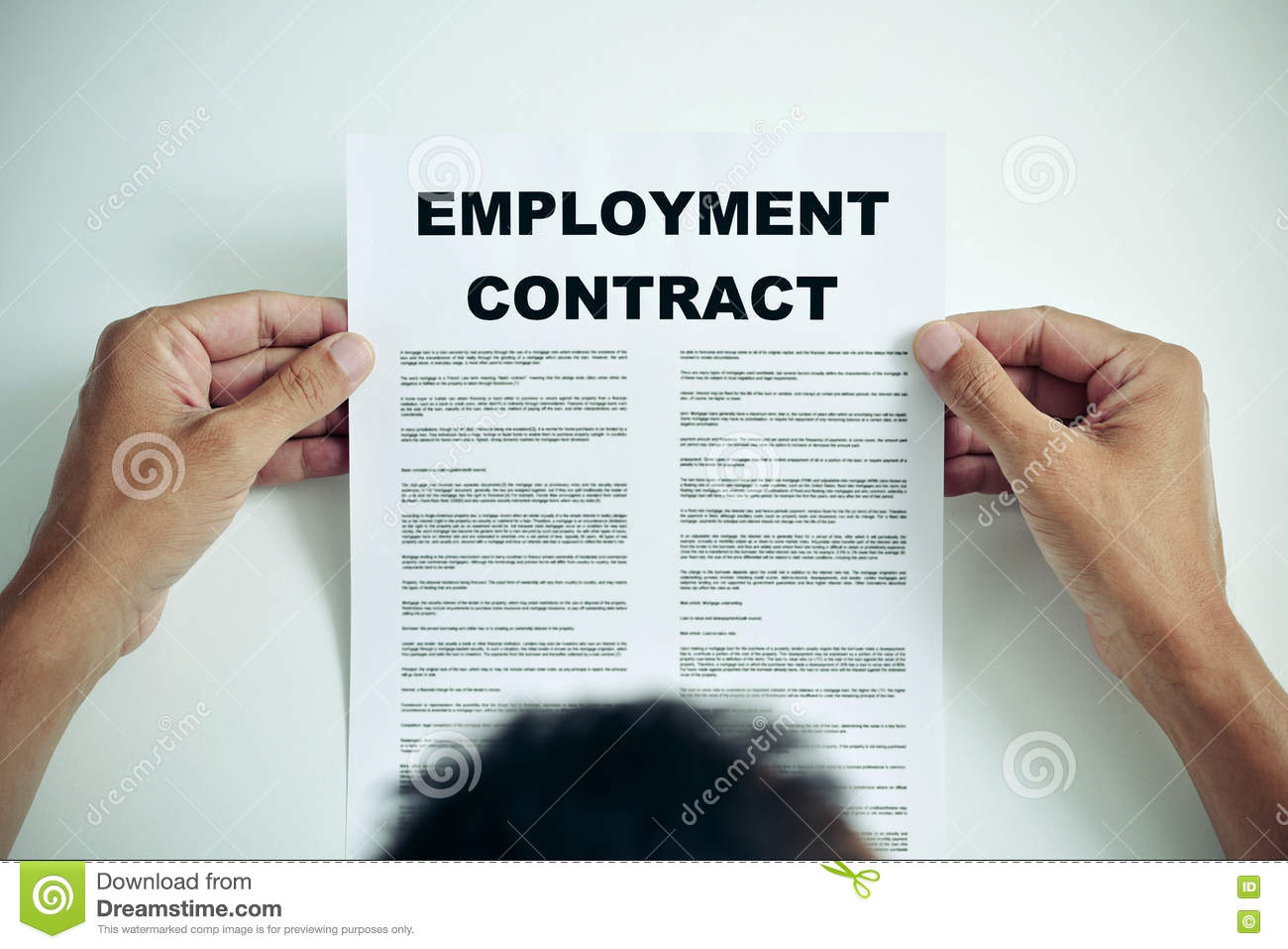 Man reading an employment contract