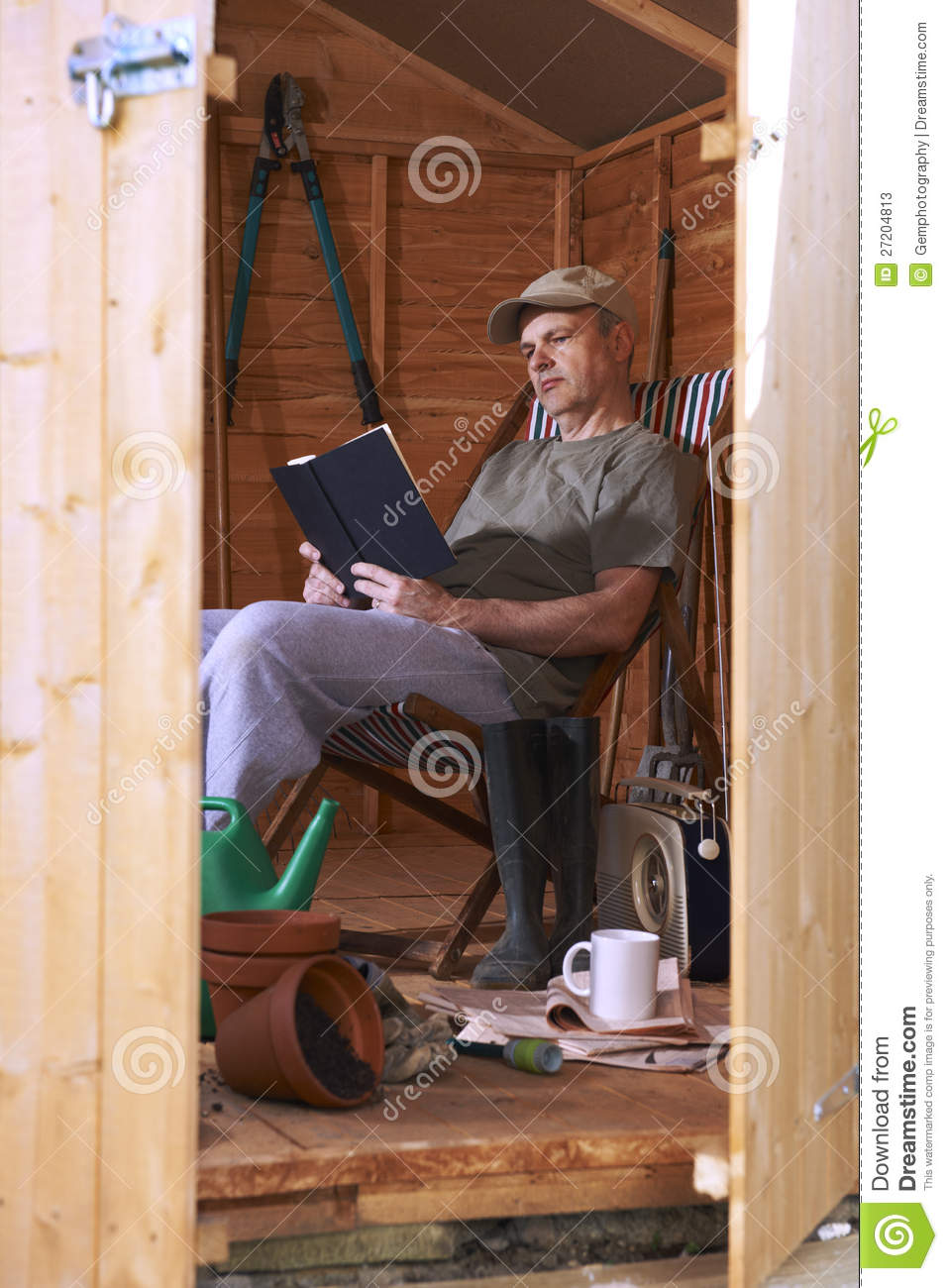 Man Reading In Garden Shed Stock Photos Image