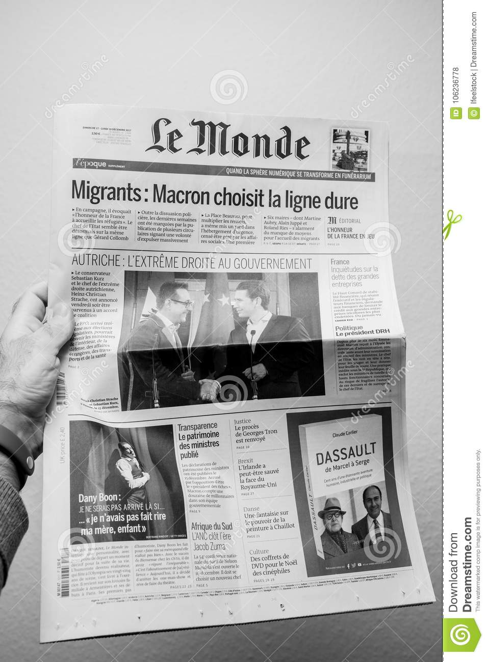 Man Reading Le Monde French Cover Newspaper With Headlight