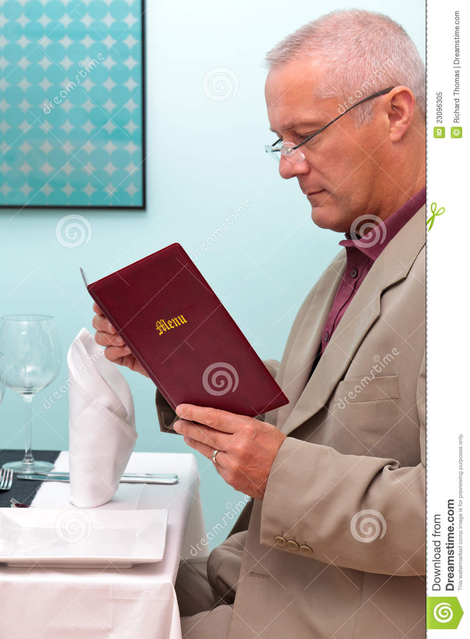 Man Reading A Menu In A Restaurant Vertical Stock Image