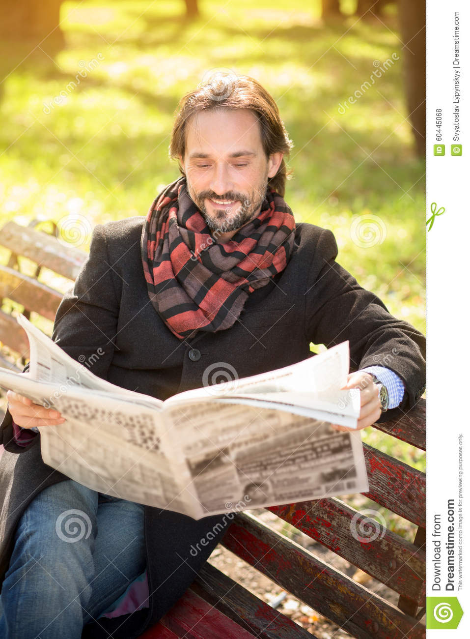 Man Reading Newpaper In The Park Stock Photo