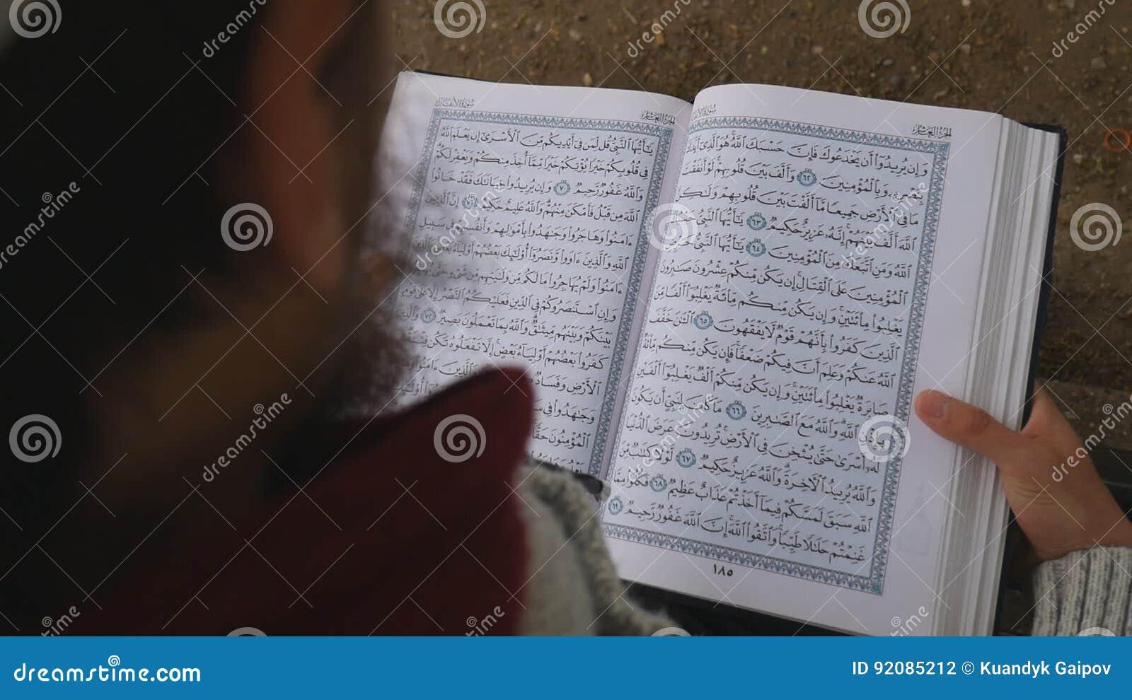 A Man Is Reading Quran  A Muslim In Ramadan  Stock Footage - Video