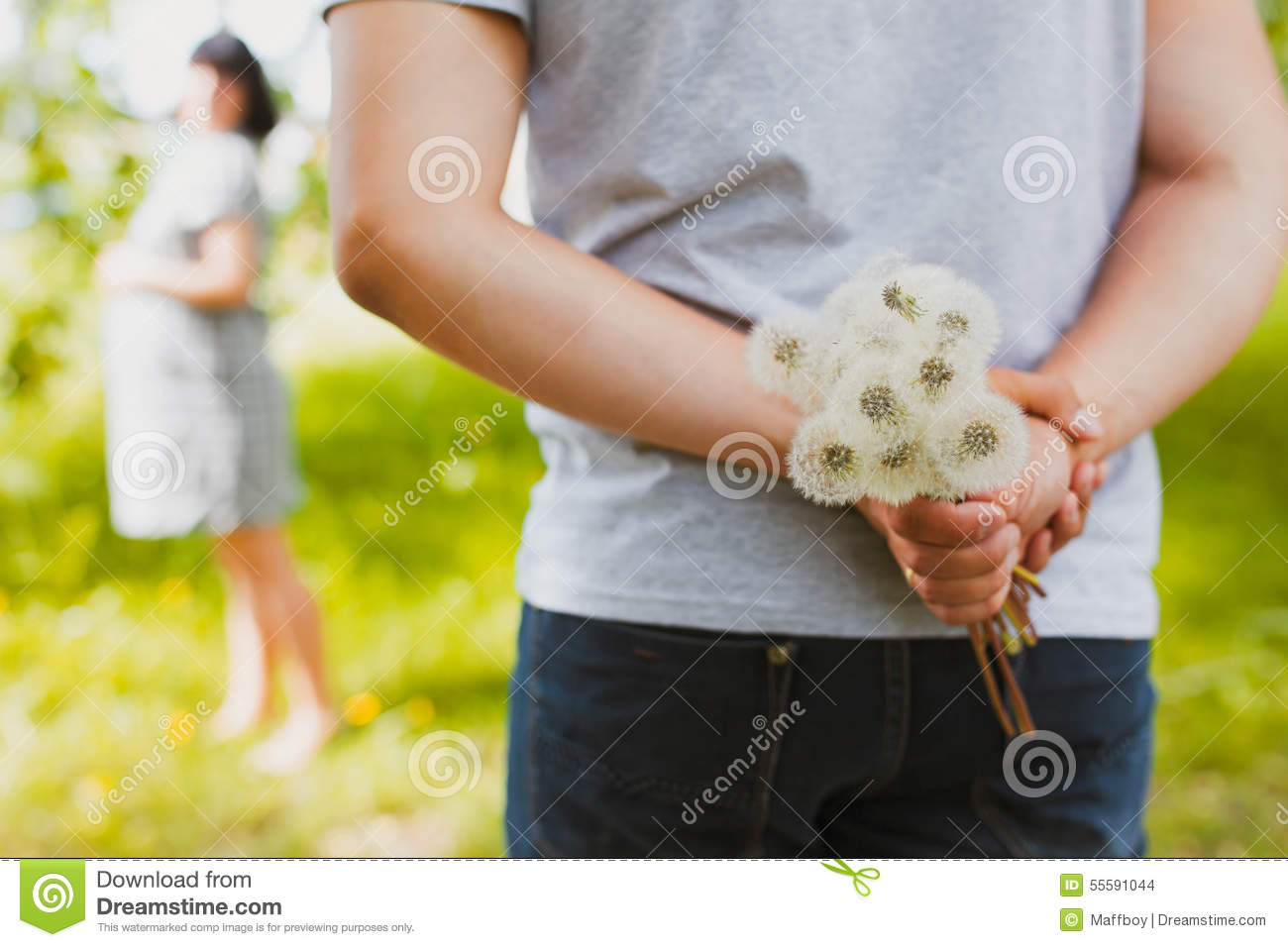 Man ready to give flowers to girlfriend