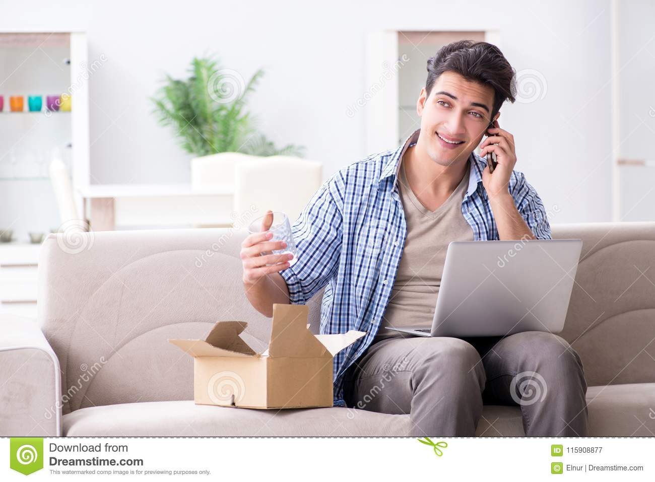 The man receiving parcel at home
